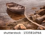 An Old Fishing Boat Is Tethere...
