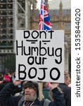 """Small photo of London, UK. Oct 19 2019. A pro Boris Johnson pro Brexit protestor demonstrating in Parliament Square holding a placard that reads """"Don't Humbug our BoJo"""" while MPs vote on the latest Brexit deal."""