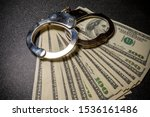 Handcuffs On Hundred Dollar...