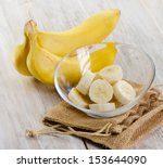 fresh bananas on wooden... | Shutterstock . vector #153644090