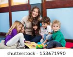 happy teacher sitting with... | Shutterstock . vector #153671990