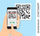 hand with phone scanning qr...