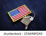 American Flag And Key From Hom...