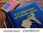 Small photo of VA loan US Department of Veterans Affairs documents and flag.