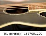 An Acoustic Bass Guitar Closeup ...