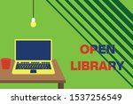 Text sign showing Open Library. Conceptual photo online access to analysisy public domain and outofprint books Front view open laptop lying on wooden desktop light bulb falling glass.