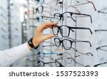 Row of glasses at an opticians. ...