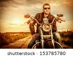 biker man wearing a leather... | Shutterstock . vector #153785780