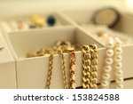 Gold Jewelry And Pearls In A...