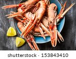 Cooked scampi served with lemon - stock photo