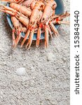 Fresh scampi served on the beach - stock photo