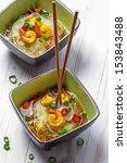 Soup with noodles and spicy shrimp - stock photo