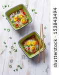 Two bowls of noodle soup with shrimp - stock photo