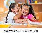 two cute girls having fun at... | Shutterstock . vector #153854888