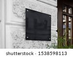 blank black glass signplate on...