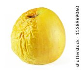 One Yellow Apple With Wrinkled...