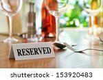 reserved sign on a restaurant... | Shutterstock . vector #153920483