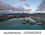 Seward Boat Harbor and waterfront in fall, Seward, Kenai Peninsula, Alaska, AK, USA. Seward is a city near Kenai Fjords National Park.