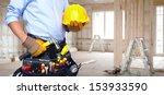 handyman with a tool belt.... | Shutterstock . vector #153933590