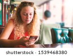 a young woman using smartphone... | Shutterstock . vector #1539468380
