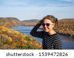 Woman Poses At The Lake Of The...