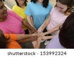 group of women with hands... | Shutterstock . vector #153992324