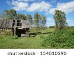 Small photo of Old abounded wooden house in a village
