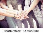group of friends pile up hands... | Shutterstock . vector #154020680