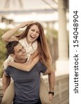 young couple laughing in the... | Shutterstock . vector #154048904