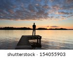 Man Standing On A Small Jetty ...