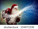 santa claus blows with hands... | Shutterstock . vector #154071530
