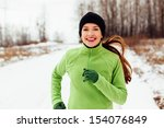 Happy Young Woman Running In...