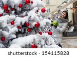 Happy girl with a Christmas gift - stock photo
