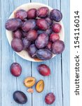 plums in a bowl | Shutterstock . vector #154116014