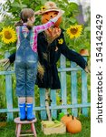 Scarecrow And Happy Girl  In...