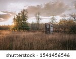 Outhouse At Sunset With Cloudy...
