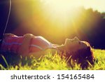 young pretty woman lying on the ... | Shutterstock . vector #154165484