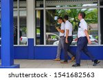 Small photo of PAPEETE, TAHITI -10 DEC 2018- View of young Mormon missionary men walking on the street in Papeete, Tahiti, the capital of French Polynesia.