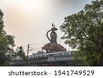 Small photo of Hanuman temple near Karol Bagh Delhi with giant 108 feet statute of Lord Hanuman with view of Delhi Metro Rail service.
