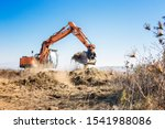 Excavator Clears Land For...