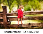 little cute child looking from... | Shutterstock . vector #154207340