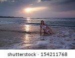 woman girl sitting sunrise... | Shutterstock . vector #154211768
