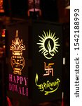 Small photo of Chinese lantern with Happy Diwali and Subh Deepavali written on it. Swastika and Mangal Ghat symbols are also there, Clicked at Kandil Galli, Mumbai