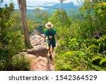 Traveler Hikes Along A Rocky...