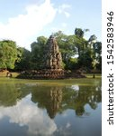 Small photo of SIEM REAP, CAMBODIA - OCTOBER 10, 2019: Neak Pean (or Neak Poan) the entwined snakes (serpents) at Angkor, is artificial island with small Buddhist temple on a circular island in Jayatataka Baray.