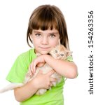 Stock photo little girl and a kitten in front isolated on white background 154263356
