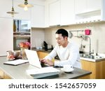 young asian man working from... | Shutterstock . vector #1542657059