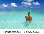 girl with coconut in the sea in ... | Shutterstock . vector #154275668