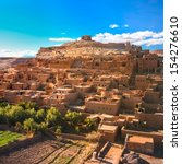 Small photo of Ait Benhaddou,fortified city, kasbah or ksar, along the former caravan route between Sahara and Marrakech in present day Morocco. It is situated in Souss Massa Draa on a hill along the Ounila River.