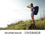 hiker with backpack enjoying... | Shutterstock . vector #154286828
